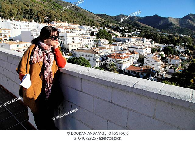 Young woman admiring the view of a 'white' touristic village - Mijas Pueblo, Costa del Sol, Andalusia, Spain
