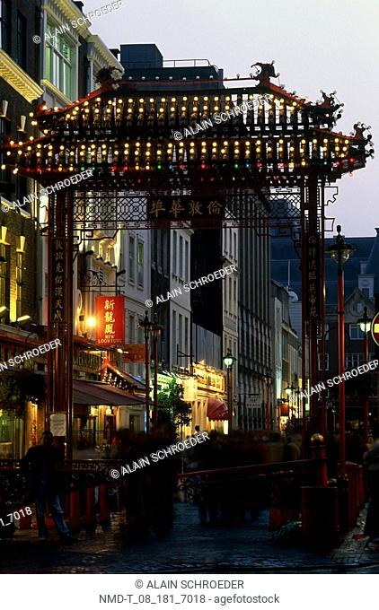 Buildings in a city lit up at dusk, Chinatown, London, England