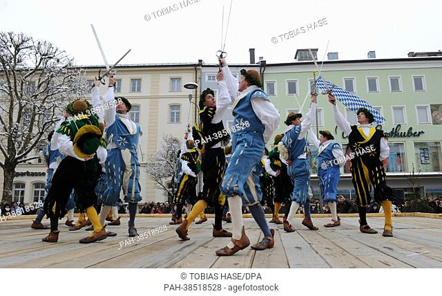 Men wearing German traditional costumes perform a 'Sword Dance' prior to the 'Georgiritt' - a horse parade in commeoration of Saint Georg - in Traunstein on...