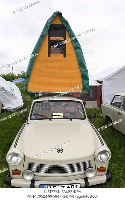 A Trabant mounted with a roof luggage rack tent parked in the Flugplatz in Anklam, Germany, 24 May 2017. Around 1000 fans of the communist-era cars will be...