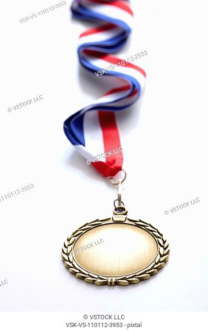 Studio shot of gold medal