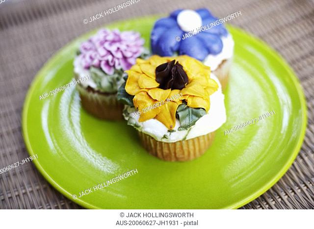 Close-up of three cupcakes on a plate