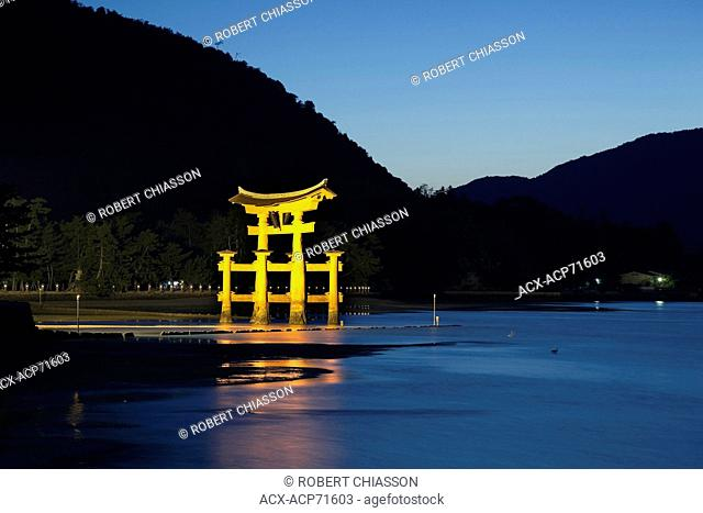 Nightime scene of the giant torii gate that is part of the Itsukushima Shrine complex on the island of Miyajima, Japan
