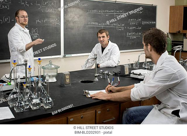 Caucasian students working in lab classroom