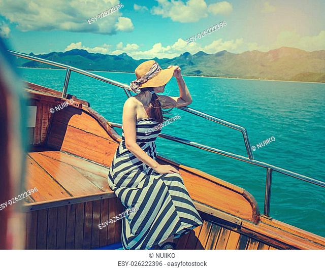 Asian woman relaxing on cruise with sunny day