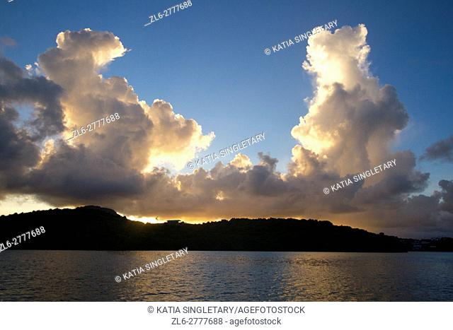 """Sunset with biloowing clouds. """"""""The white ocean botton"""""""" or """"""""bathtub of Josephine """""""" is a famous place in Martinique. This is a place where the Empress..."""