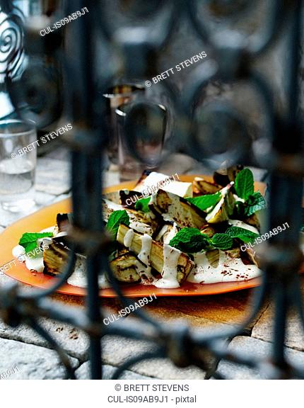 Plate of roasted eggplant with yogurt