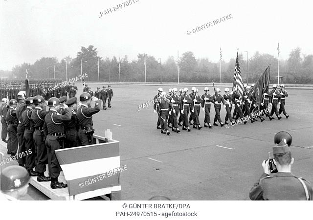 Soldiers of the 6th US infantry marching past a VIP stand on occasion of a parade for the 155th anniversary of their regiment on 16th October 1953