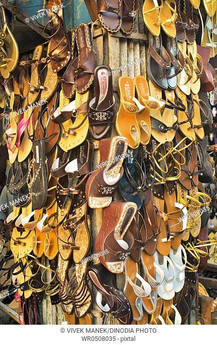 Ladies footwear for sale sandal roadside stall , New Market , Dhaka , Bangladesh