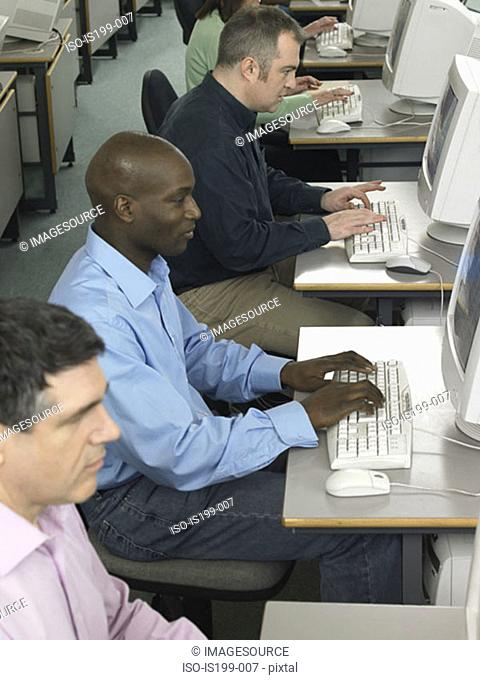 Mature students using computers