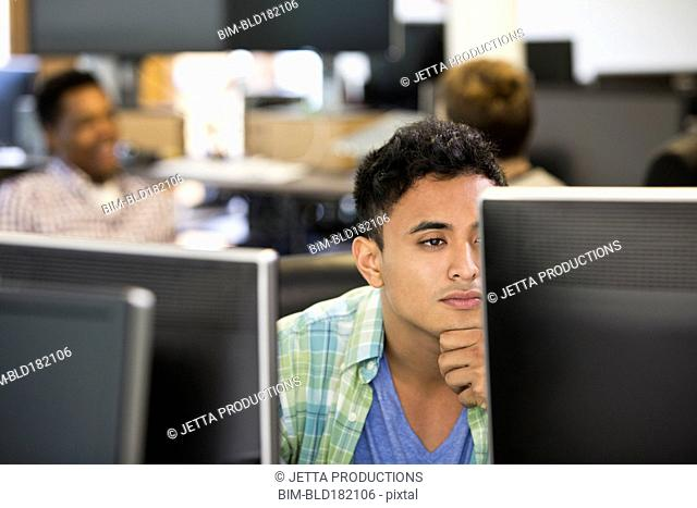 Businessman working at computer in office