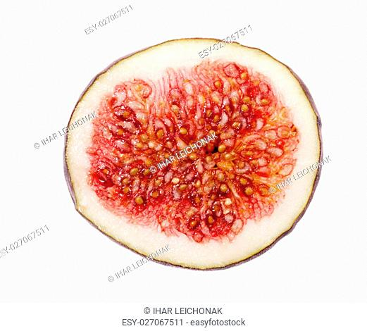 photographed close-up of red ripe fresh figs, cut into two halves