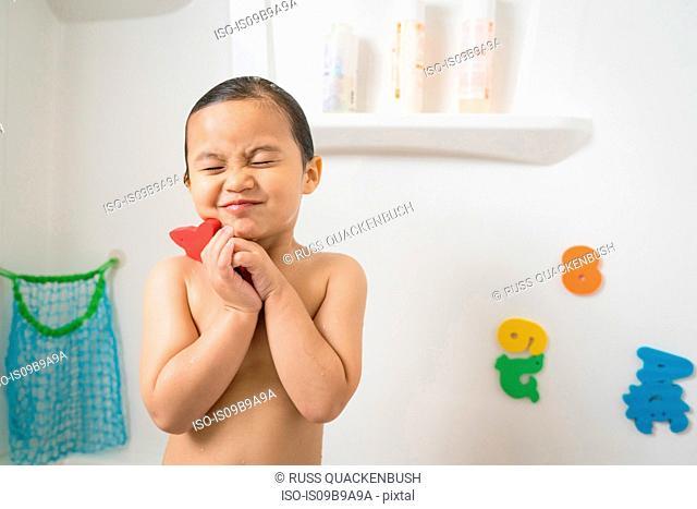 Little boy in bath tub at bath time
