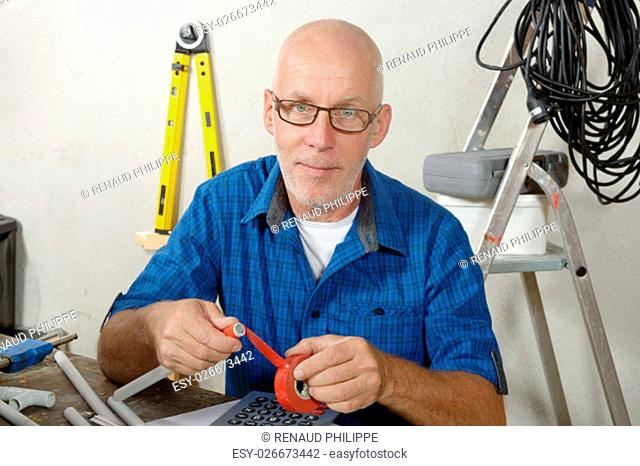 a portrait of an electrician man in his workshop