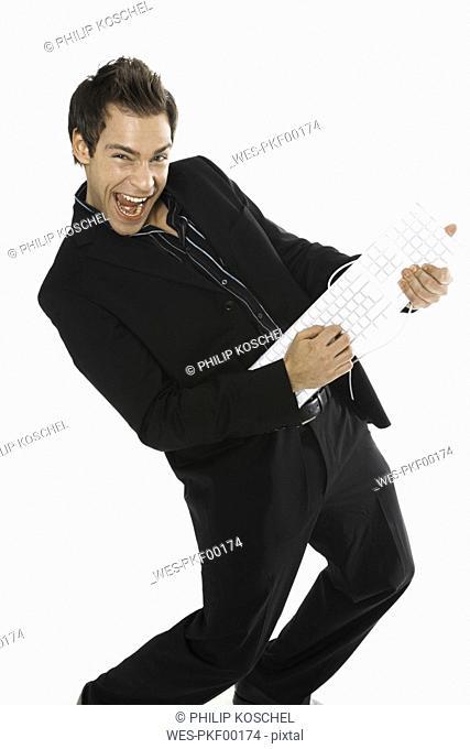 Young man holding keyboard, close-up