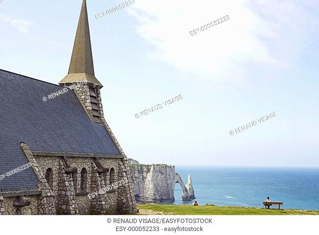 Rock chapel on the Falaises d'Amont with arch in background. Etretat. Normandy. France