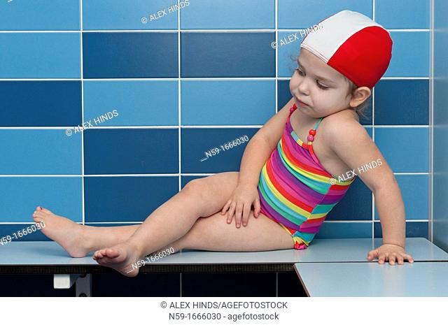 Three year old girl at swimming pool ready for a swimming lesson