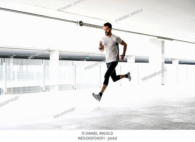 Man running in parking garage