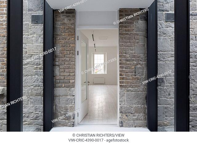 Corridor link of old and new. Dublin Military Archives, Dublin, Ireland. Architect: McCullough Mulvin Architects, 2016