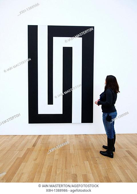 Woman looking at modern art painting at Bonn Kunstmuseum or Art Museum in Germany