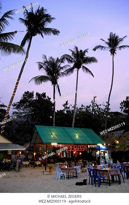 Thailand, Small bars and restaurants between palm trees on White Sand Beach at Mu Ko Chang National Park