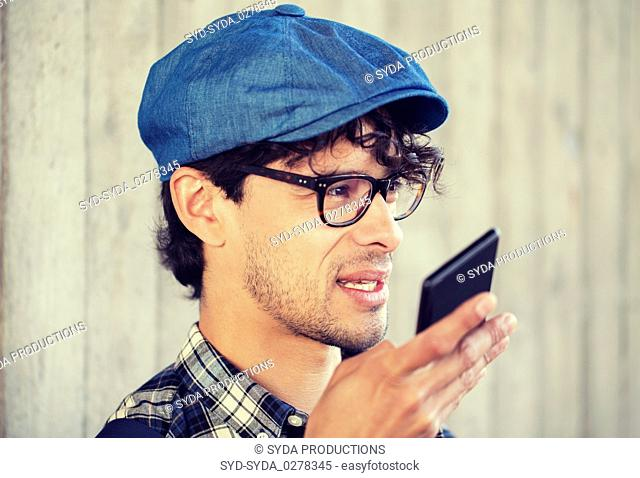 man recording voice or calling on smartphone