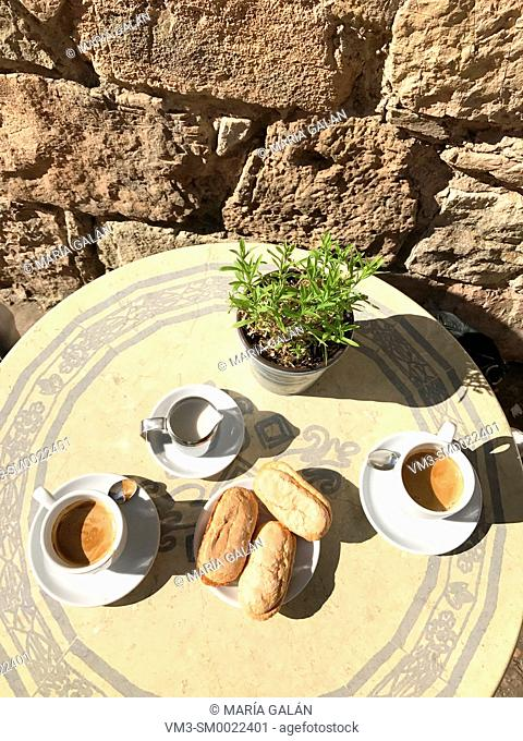 Two cups of coffee with milk and biscuits for breakfast in a terrace. Medinaceli, Soria, Spain