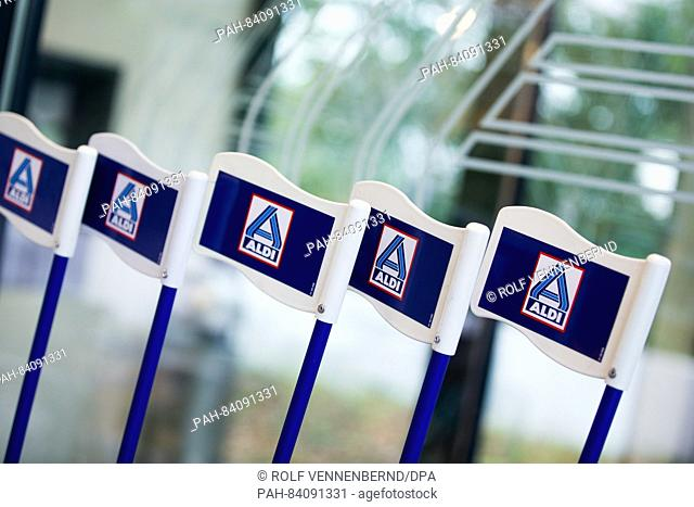 Flags carrying the logo of Aldi Nord seen in a newly designed Aldi Nord store in Gladbeck, Germany, 20 September 2016. Discount supermarket chainAldi...