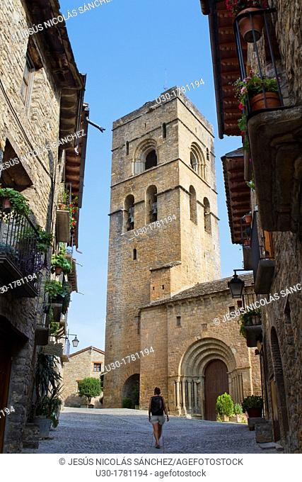 Street and bell tower of the romanesque church of Santa Maria, in Aínsa, a medieval village in Sobrarbe region, declarated Historical-Artistic Site  Huesca