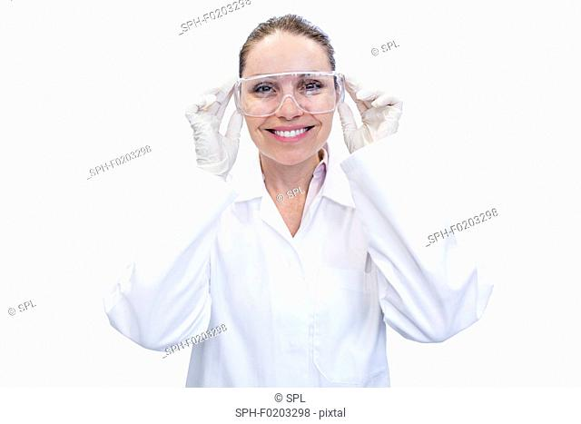 Lab assistant adjusting safety goggles