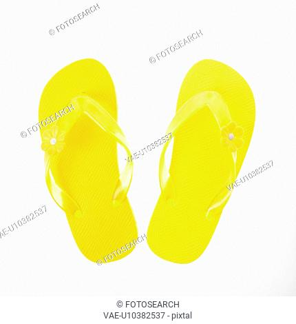 6e244277366ae Yellow plastic thong sandals Stock Photos and Images
