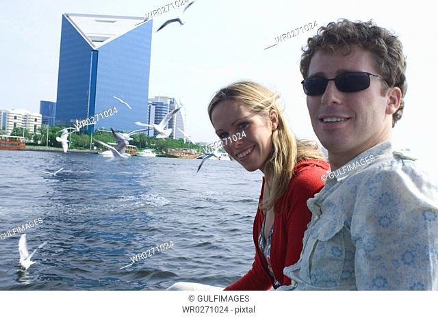 Couple on Abra at Dubai Creek, United Arab Emirates