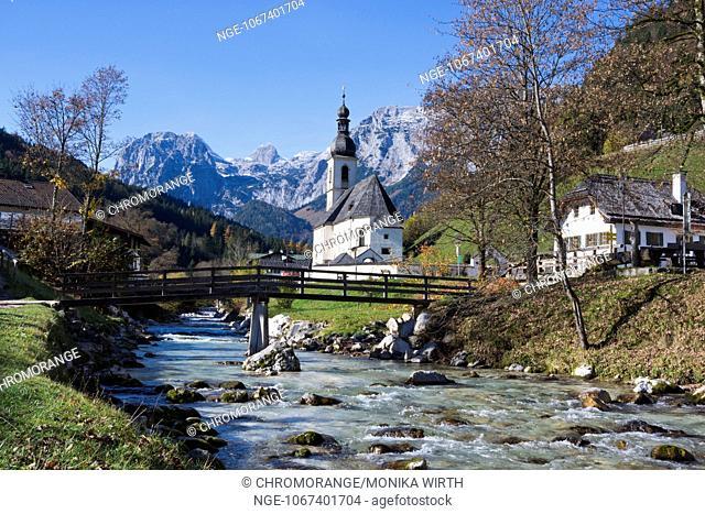 Parish church of St. Sebastian with Ramsauer Ache, in the background the Reiteralm, Ramsau near Berchtesgaden, district Berchtesgadener Land, Upper Bavaria