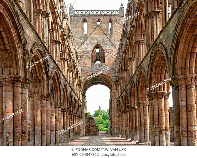 View at arches inside ruins of Jedburgh abbey in Scottish borders
