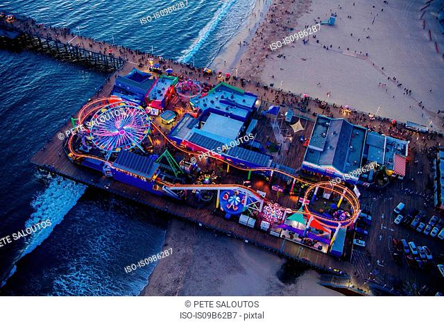 Overhead view of amusement park at dusk, Santa Monica, California, USA