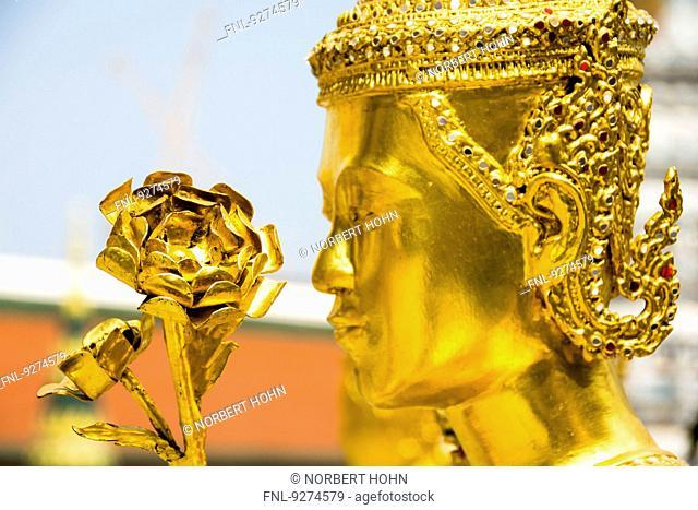 Golden Temple figure in Wat Phra Kaeo in Bangkok, Thailand