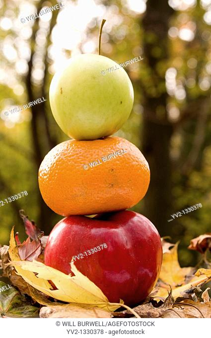 Two apples and an Orange stacked