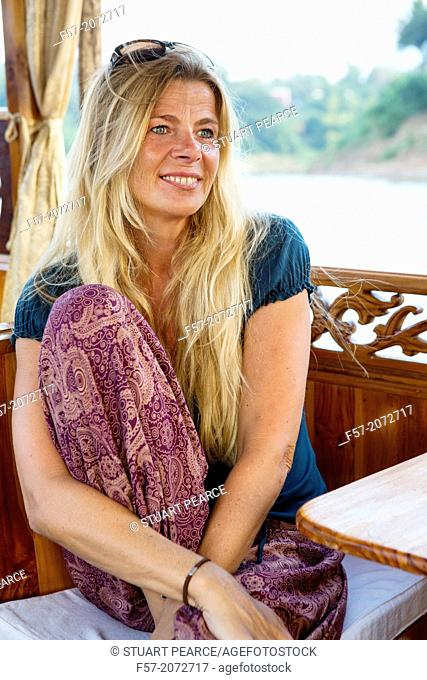 Female tourist on a boat on the Mekong River in Luang Prabang, Laos