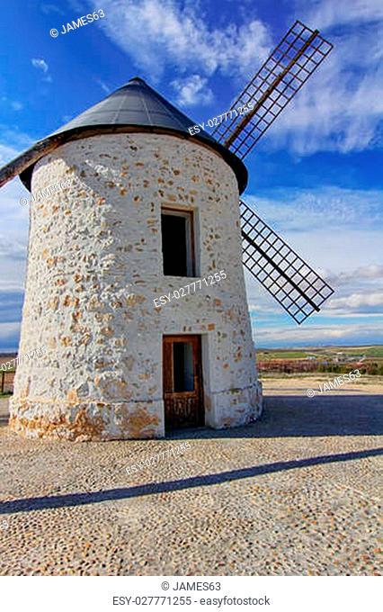 old Windmill XVI century white stone and wood