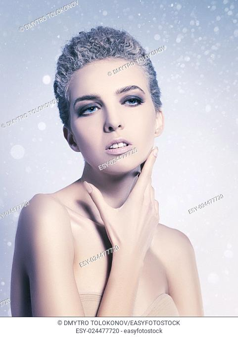 Frozen beauty, abstract vogue style female portrait with beauty bokeh