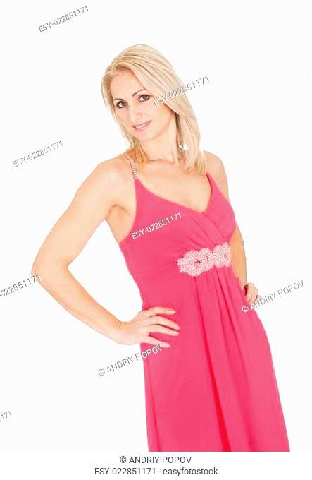 Beautiful young woman posing in dress
