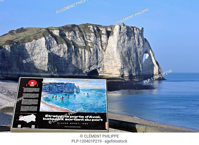 Sign showing painting by Claude Monet of the Porte D'Aval, a natural arch in the chalk cliffs at Etretat, Côte d'Albâtre, Upper Normandy, France