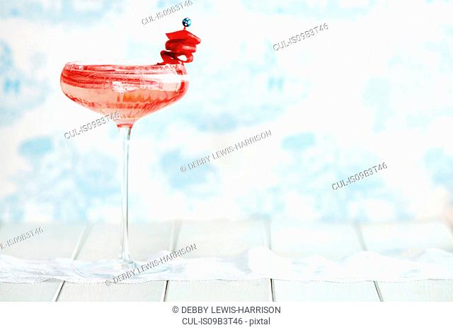 Non-alcoholic cocktail in champagne glass with rhubarb