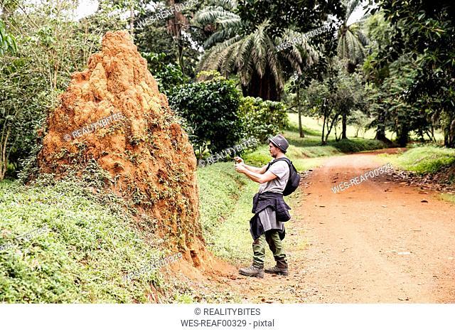 Uganda, Entebbe Botanic Gardens, Tourist taking pictures of