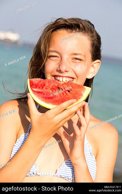 Girl, watermelon, laughing