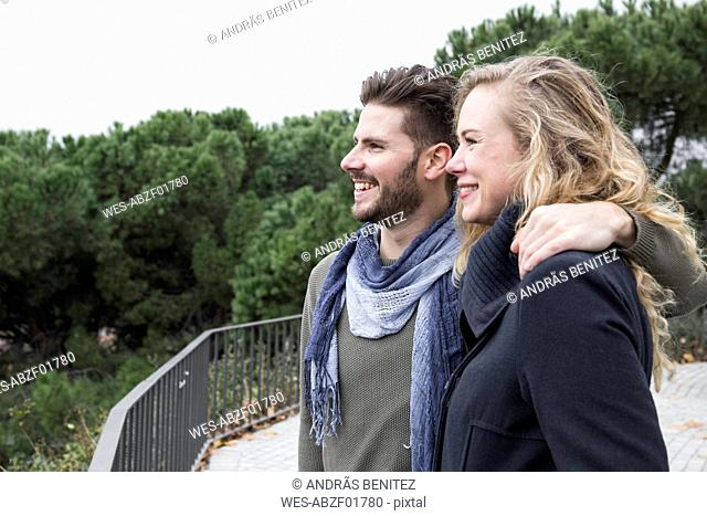 Couple smiling looking at view