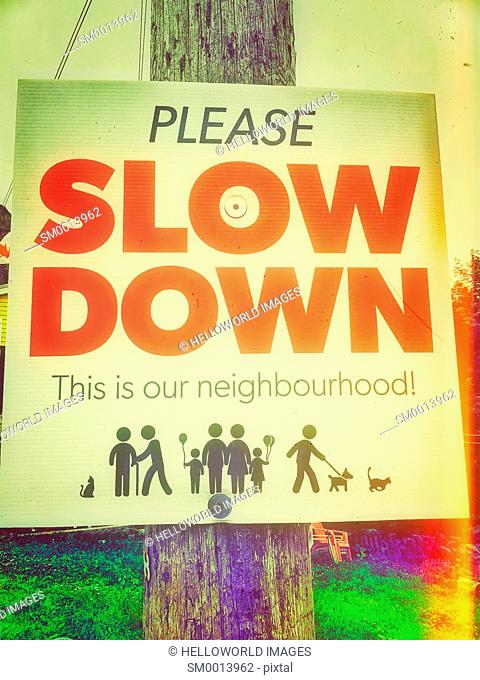 Neighbourhood please slow down sign, Canada