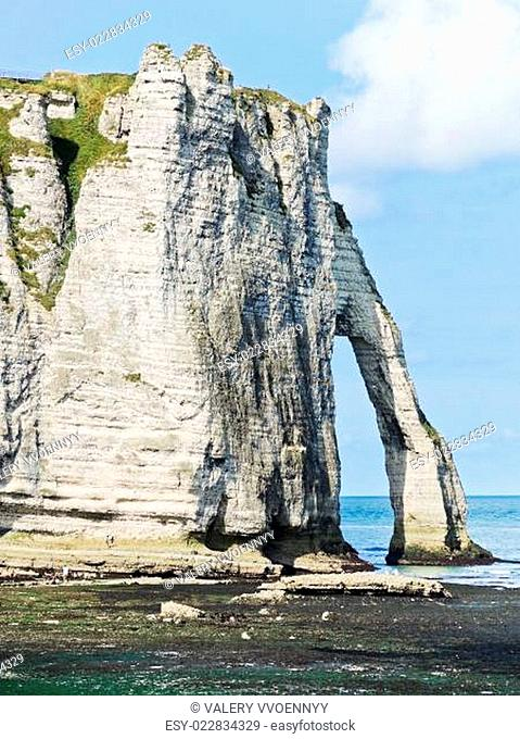 cape with arch on beach of Eretrat