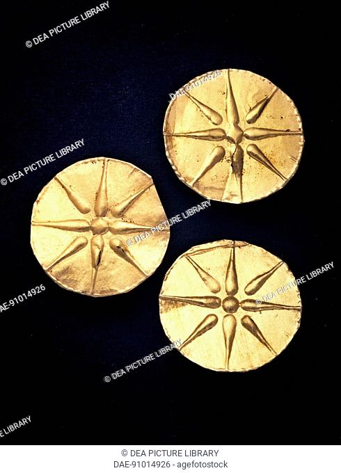 Gold discs with Macedonian star relief, from the royal tomb of Philip II, Vergina (Greece). Goldsmith art, Greek Civilization, 4th Century BC