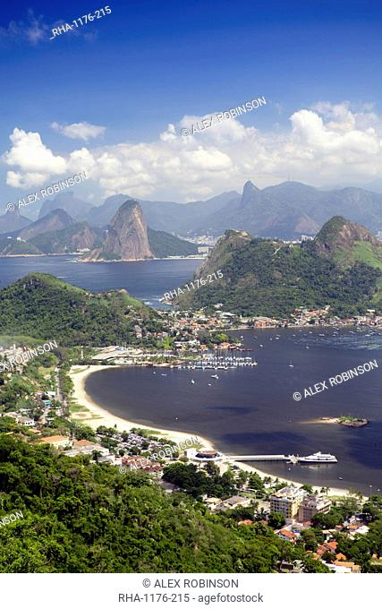 View of Rio, the Serra da Carioca mountains and Sugar Loaf with Charitas and Sao Francisco beaches in Niteroi in the foreground, Rio de Janeiro, Brazil